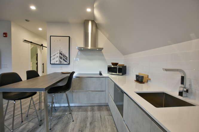 The Vandermarck features Herman Miller furniture